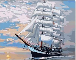 Ship with White Sails at Sunset