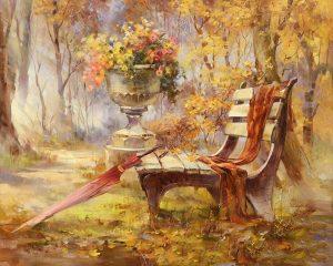Empty bench with umbrella