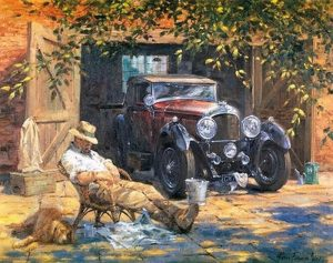 Man resting by vintage car in the sun