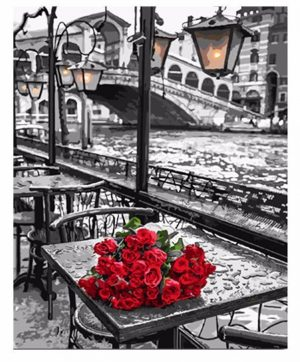 Bunch of Roses by a table
