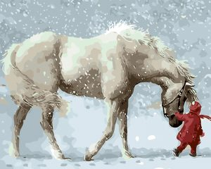Child in red leading white horse