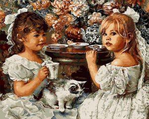 Two girls in white having tea